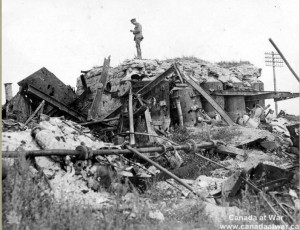 Canadian soldier stands atop the rubble remaining of the Sugar Factory, destroyed on September 15, 1916