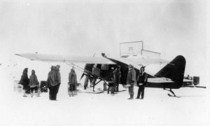 Pilot Wop May and crew loading up the aircraft in Aklavik, NWT in the hunt for the Mad Trapper